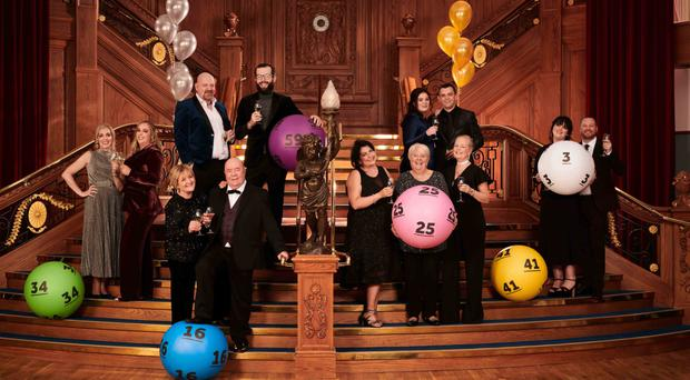 Celebrating 25 years of the National Lottery are NI winners (from left) Anne Canavan and daughter Cressida, Eithne and Colin Bell, Stephen Inglis and son Ian, Mary Hamilton with nieces Antoinette and Kathy, Claire Marks and husband Clifford, and Stephanie Harkin with husband Kieran