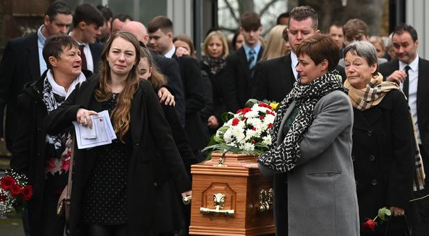 The coffin of Willie Gribben is brought out of Seagoe Parish Church in Portadown yesterday