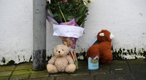 Flowers and tributes outside the house in Keady where Hunter McGleenan died