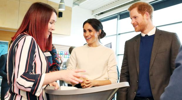 Sinead Murphy from Shnuggle shows Prince Harry and Meghan Markle the firm's baby bath
