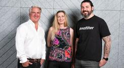 Aaron Taylor with Lisa Donaldson, head of brand and design, and Scott Ritchie