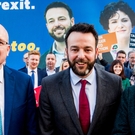 SDLP leader Colum Eastwood and colleagues outside the Bishop's Gate Hotel in Londonderry