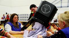 Ballot boxes are opened at the leisure centre in Omagh last night