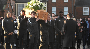Teammates from Carrick Rangers during the funeral of Irish League footballer Jerry Thompson at Sacred Heart Church in Belfast