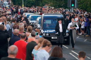 People line the streets as the funeral cortege of Jack Charlton passes through his home town of Ashington in Northumberland yesterday