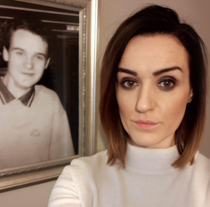 Claire Monteith in front of a picture of her brother Alan Radford
