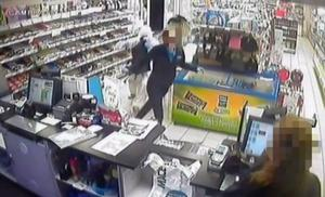 A young worker is dragged through the petrol station