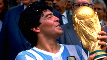 Legend: Diego Maradona lifts the trophy and celebrates Argentina winning the World Cup in 1986