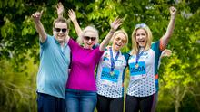 Jo-Anne Dobson (right) and son Mark (far left) with Emma Donaghy and her mum, Claire, at the Belfast Marathon yesterday