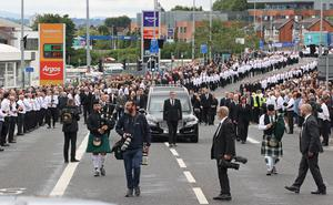 Hundreds lined the streets of west Belfast for Bobby Storey's funeral (Liam McBurney/PA)