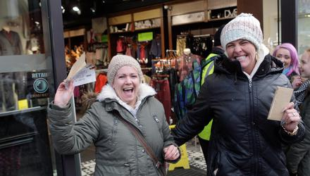 One Direction fans Zoe Buchanan and Melissa Dickson with the first tickets sold in Ticketmaster, Belfast city centre, in 2014