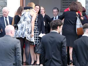Grieving family and friends at Jay's funeral