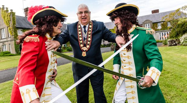 Royal Black Institution's Rev William Anderson attempts to keep King William (left) and King James apart ahead of this year's event