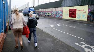 The largest peace wall in Belfast, as a report warned children are still growing up divided and segregated by religion in Northern Ireland