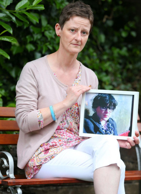 Liz Stott holds a photograph of her daughter Sophy