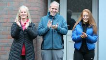 Harry Fay with wife Geraldine and daughter Amy outside their home last night