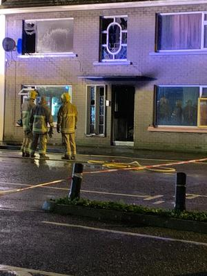 Escape: Firefighters at the scene in Ballymoney