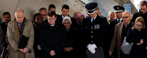 The memorial service at South Quay station attended by survivors and emergency services