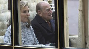 The Duke of Edinburgh and Maria Clemencia Rodriguez de Santos arrive by carriage at Buckingham Palace