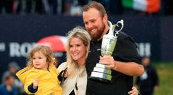 Ireland's Shane Lowry with the Claret Jug, accompanied by wife Wendy and daughter Iris, after winning the 148th Open Championship at Royal Portrush