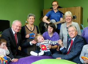 First Minister Peter Robinson, Deputy First Minister Martin McGuinness, Tina McCrossan, Director of Children's Services and Dame Judith Hill, NI Hospice CEO at the announcement of £1million funding for the Northern Ireland Children's Hospice, with staff members and children Lacey Pollock and Stefan McAuley