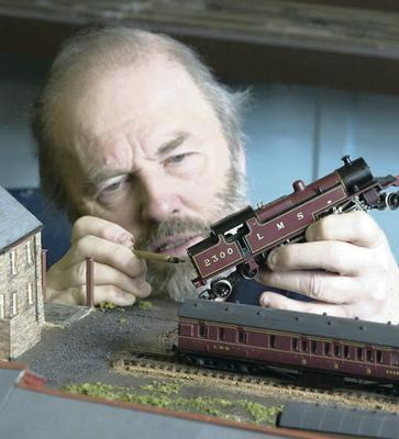Derek does some close-up work on a model