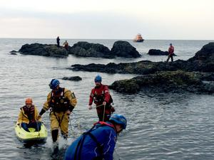 Coastguards from Ballycastle rescue a father and son who were cut off on a rock while fishing at Portbradden on the north coast of Co Antrim