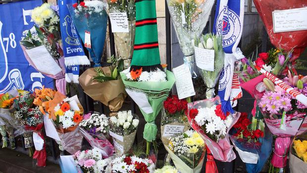 Floral tributes placed at the scene where father-of-two Ian Ogle was murdered by UVF thugs last week