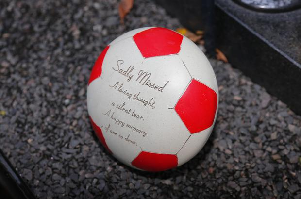 Fans of the late football superstar regularly visit the grave to leave mementoes