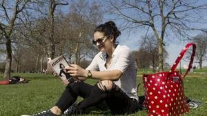 Rita Sousa, 19, enjoys the warm weather in Hyde Park, London, as Britain could bask in the warmest weather of the year this weekend as temperatures soar to 19C (66.2F).