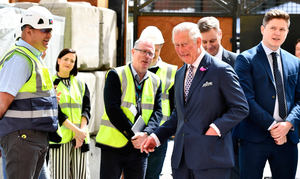 The Prince of Wales meeting workers during a visit to Bank Buildings
