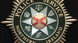 'Police said two men on a red Triumph motorcycle pulled up beside a black Range Rover as it slowed down at the junction. The passenger got off the bike and damaged the vehicle's windshield by striking it with a metal chain'