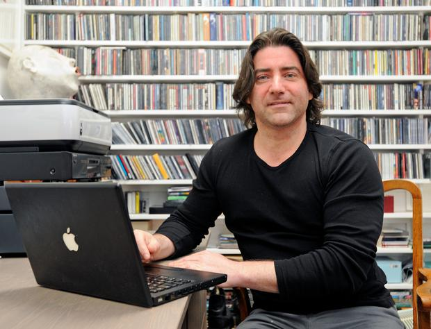 Brian Kennedy at his laptop