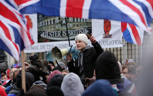 Jamie Bryson speaks at a flag protest in Belfast