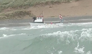 Video footage of a boat cut adrift by vandals as attempts are made to secure the vessel