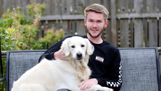 Michael Rooney with his Golden Retriever Mia