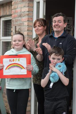 John and Laura Gallagher and their children Abbie and Oran who have been showing their support for carers every Thursday outside the family home in Derry's Waterside. Picture Martin McKeown. 09.04.20