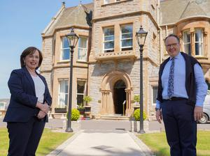Diane Dodds with hotelier Howard Hastings at the Culloden Hotel outside Belfast as she announced the planned reopening of hotels on July 20 (Aaron McCracken/PA)