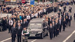 Crowds gather as the funeral of Bobby Storey takes place in west Belfast last June