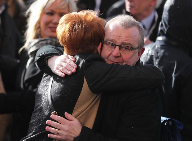 Families embraced after the march (Niall Carson/PA)