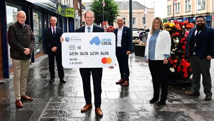 Pictured in Carrickfergus with Economy Minister Gordon Lyons are, from left, Lee Britton, PFS; Roger Pollen, FSB NI; Colin Neill, Hospitality Ulster; Sarah Cunningham, Mastercard; and Aodhán Connolly, NI Retail Consortium