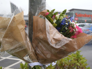 Flowers at the scene of the shooting
