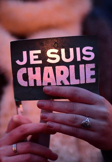 A woman holds a sign reading Je suis Charlie (I am Charlie) in tribute to the victims