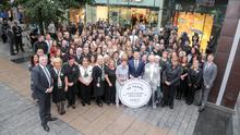 Marks & Spencer staff celebrating the 50th anniversary of the company's operations in Northern Ireland in 2017