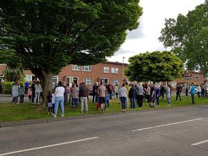 People outside the home of Teddy Dixon