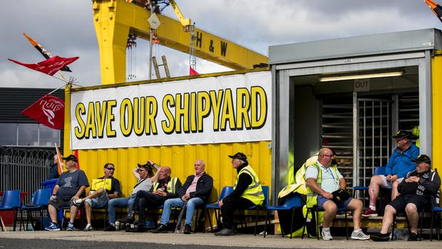 Employees of Harland and Wolff during their protest at the gates of the shipyard in Belfast (Liam McBurney/PA)