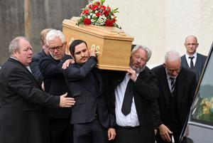 Family and friends at the funeral of Alan Campbell in Belfast yesterday