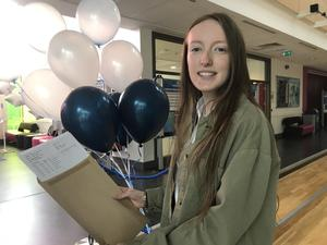 Caitlin Martin receives her GCSE results at Ashfield Girls School in east Belfast. (Rebecca Black/PA)