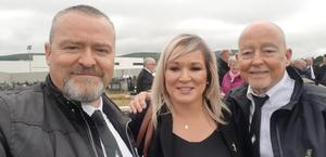 Michelle O'Neill posing for a selfie with two attendees at Bobby Storey's funeral (Lucan Sinn Fein/Facebook/PA)