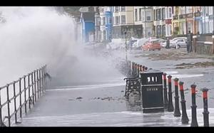 Waves crash over into the street in Whitehead